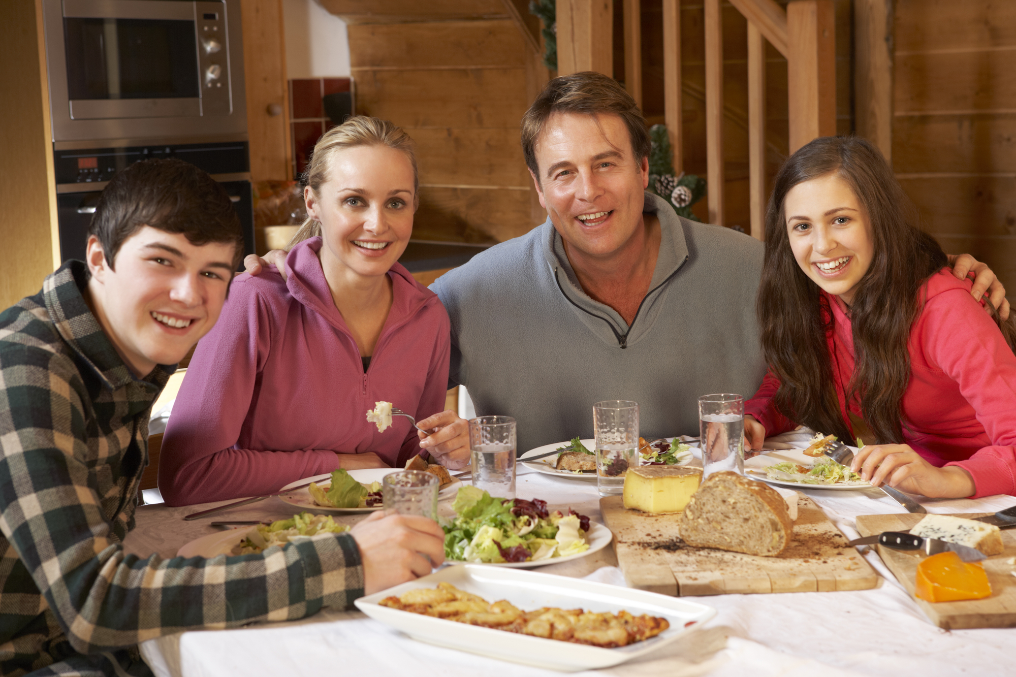 Family With Teenagers Enjoying Meal Together